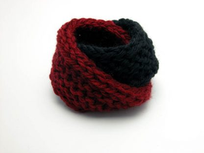 Hand knit double mobius bracelet in burgundy and black wool by Kate Wilcox-Leigh