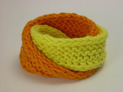 Hand knit double mobius bracelet in buttercup and mango fool cotton by Kate Wilcox-Leigh