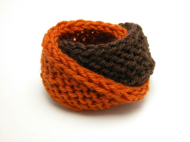 Hand knit double mobius bracelet in pumpkin and brown wool by Kate Wilcox-Leigh