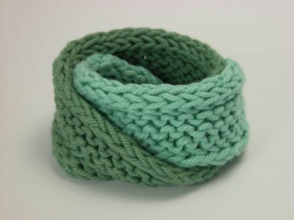 Hand knit double mobius bracelet in seafarer and slippery cotton by Kate Wilcox-Leigh