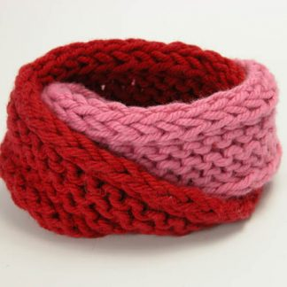 Hand knit double mobius bracelet in slick and rosso cotton by Kate Wilcox-Leigh