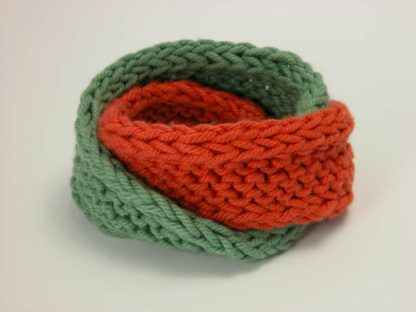 Hand knit double mobius bracelet in slippery and flame cotton by Kate Wilcox-Leigh